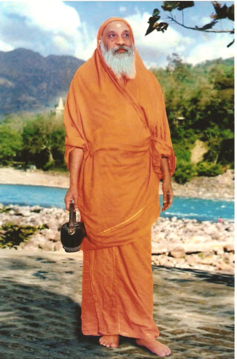 Swami Dayananda at the Ganga with Kamandalu (water pot)