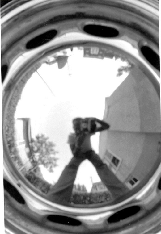 Dad photographing himself in the hubcap of his Porsche, c. 1965
